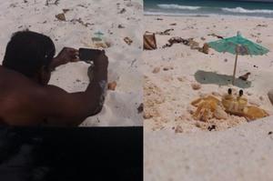 老公一到海邊就立刻趴在沙灘上,問他在幹嘛也都不講話...靠近一看立刻笑了出來!!